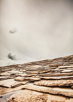Clouds over rooftop - p075m1467856 by Lukasz Chrobok