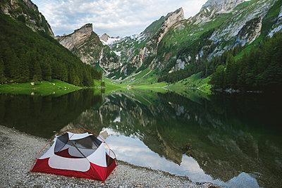 Tent by Seealpsee lake in Appenzell Alps, Switzerland - p1427m2146895 by Oleksii Karamanov