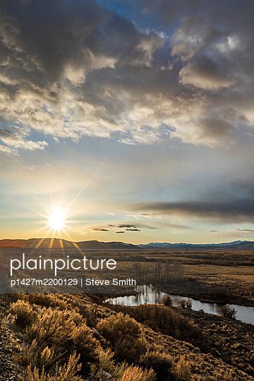 USA, Idaho, Picabo, Sunset over plain and mountain range - p1427m2200129 by Steve Smith