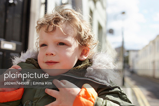 Little boy outdoors, wearing parka - p924m744565f by Emma Kim