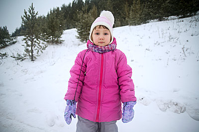 Portrait of girl on snow covered field - p1166m1095737f by Cavan Images
