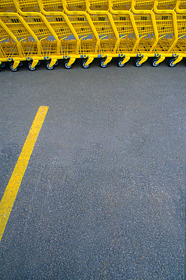 Yellow shopping carts at supermarket. - p1328m1165922 by Pierre Desrosiers