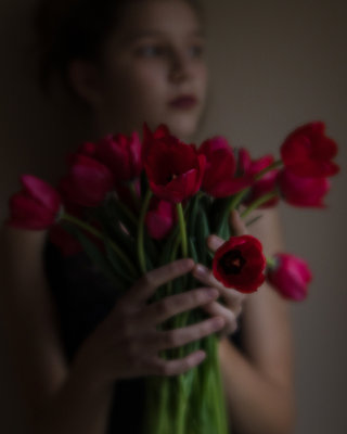 Girl Holding Tulips - p1503m2031830 by Deb Schwedhelm