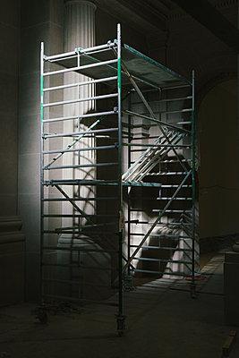 Illuminated scaffolding in dark museum - p301m2018076 by Halfdark