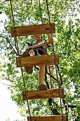 Boy on a zip Line - p445m1051402 by Marie Docher
