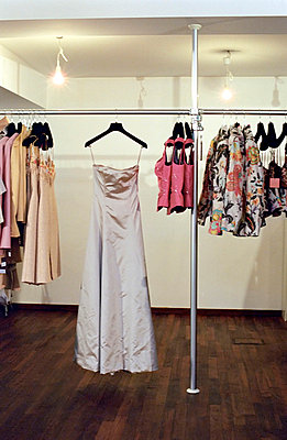 Noble clothes hanging from a Clothes-Rail - Fashion-Studio  - p4901107 by Felbert & Eickenberg