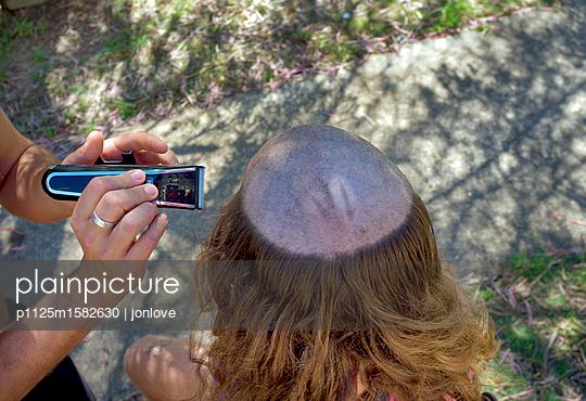 Cutting hair - p1125m1582630 by jonlove
