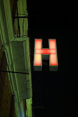 Neon sign on hotel front - p1063m1538378 by Ekaterina Vasilyeva