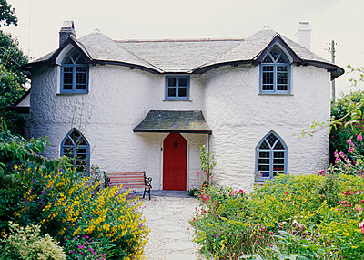 Cottage c.1790s; Picturesque features: gothick windows and circular bays, Regency style, summer garden. Philleigh, Cornwall. - p8551804 by Philippa Lewis
