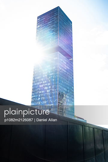Skyscraper with sunbeams in the middle - p1082m2126087 by Daniel Allan
