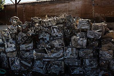 Bundles of compressed trash in the scrapyard - p1315m1565915 by Wavebreak