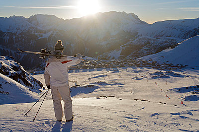 Skier looking over Alpe d'Huez. - p4295479 by Ross Woodhall