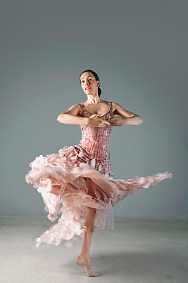 Ballet dancer posing in ornate gown - p64115829f by Maria Teijeiro