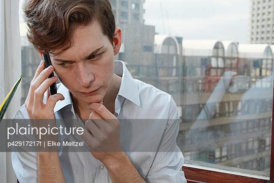 Businessman talking on cell phone - p42917217f by Elke Meitzel