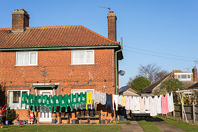 Cloths line with sports kit - p1201m1538789 by Paul Abbitt