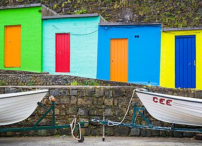 Portugal, Azores, Sao Miguel Island, Porto Formoso, fishing shacks - p651m2006670 by Walter Bibikow