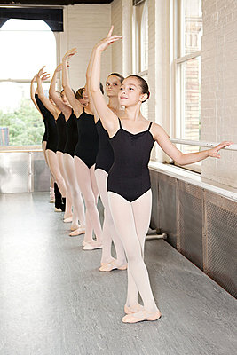 Ballerinas in pose at barre - p9245494f by Image Source