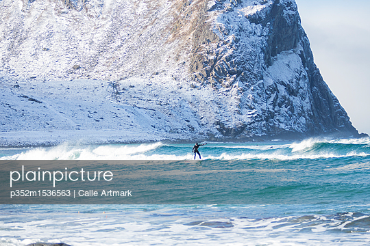 Surfer in Lofoten, Norway - p352m1536563 by Calle Artmark