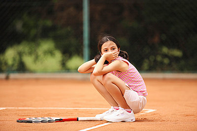 Girl Sitting In Clay Court - p3071253f by Koji Aoki