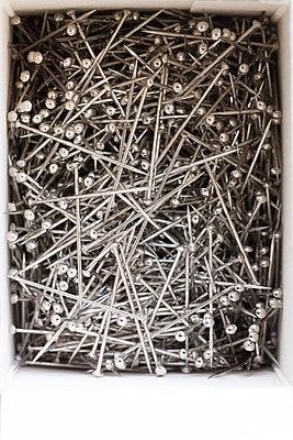 Box full of pins - p1682m2260744 by Régine Heintz