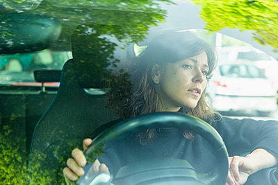 Woman driving car - p301m2123026 by Marco Baass