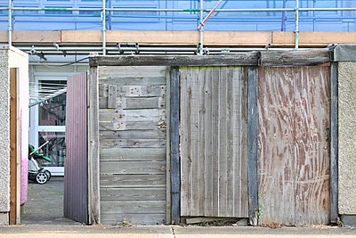 Re-using wood panels for social housing fence - p1048m1417517 by Mark Wagner