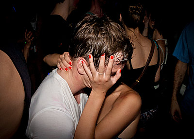 Close up of couple kissing at party - p555m1409018 by Shestock