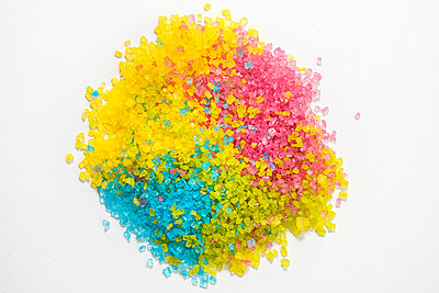 Colourful sugar crystals on a white background - p1057m2285947 by Stephen Shepherd