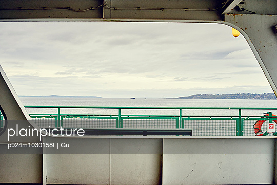 View of Puget Sound from ferry window, Seattle, Washington State, USA - p924m1030158f by Gu