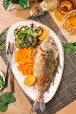 Fried fish with baby carrots and salad - p1427m2067383 by Aleksandr Kuzmin