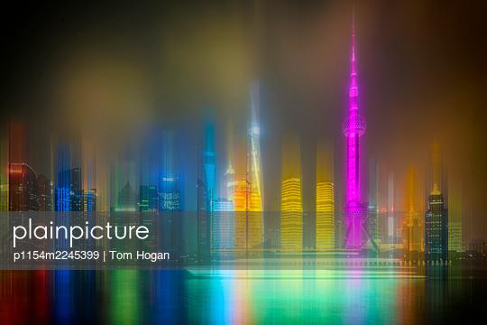 China, Shanghai, Skyline at night - p1154m2245399 by Tom Hogan