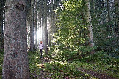 Girl walking through a forest  - p1612m2223689 by Heidi Coppock-Beard