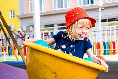 Portrait of happy little girl having fun on a playground, Spain - p300m2180750 by Irina Heß