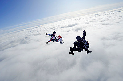 Two people flying above clouds - p31226170 by Hans Berggren