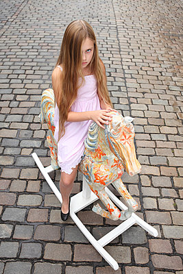 Girl on her rocking horse - p045m853385 by Jasmin Sander