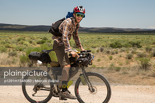 Cyclist on Mountain Bike - p1291m1548083 by Marcus Bastel