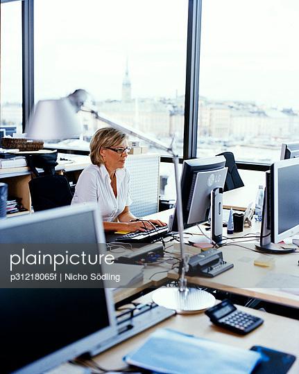 A woman in an office Sweden.