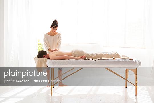 Female Massage Therapist Giving Man Back Massage