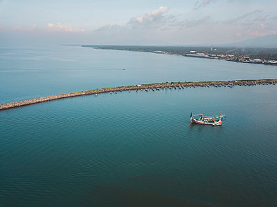 Aerial view of harbor mole - p1166m2094238 by Cavan Images