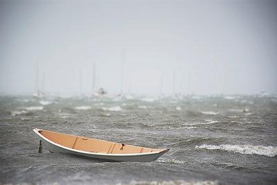 Rowboat on sea - p1427m2186451 by Chris Hackett