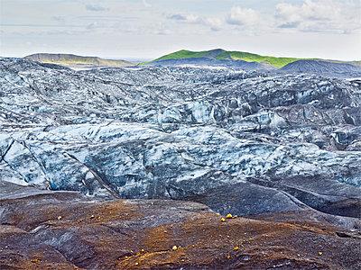 Snow on remote rock formations, Myrdalsjokull Glacier, South Iceland, Iceland - p555m1411822 by Jeffrey Davis