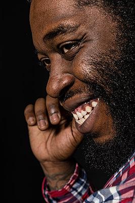 Portrait of a métis man smiling - p590m1511372 by Philippe Dureuil