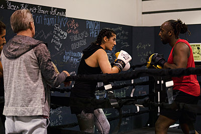Boxers training together in gym - p1192m2033941 by Hero Images