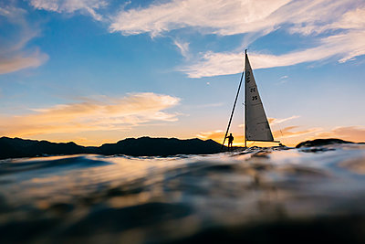 A sailboat on Lake Tahoe at sunset. - p1424m1500683 by Andrew Peacock
