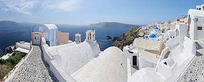 View of Oia village with cobbled path and bell tower at Santorini - p300m731247f by Martin Rügner