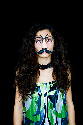 Girl with moustache - p4262878f by Tuomas Marttila
