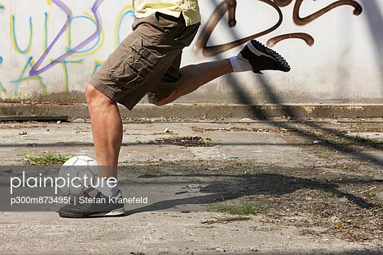 Man playing street soccer