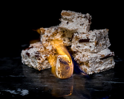 Homemade S'mores Marshmallows Behind a Flaming Marshmallow - p1166m2169221 by Cavan Images