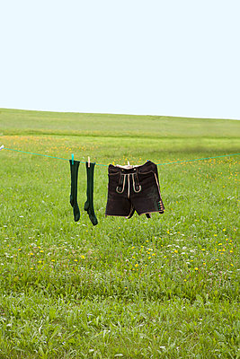 Socks and trousers on clothes line in Bavaria - p4410496 by Maria Dorner