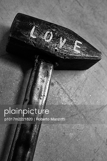 Hammer with writing, love - p1017m2221820 by Roberto Manzotti